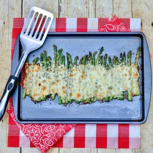 Easy Cheesy Sheet Pan Asparagus is the perfect side to go with all your meals! It's topped with ooey gooey cheese and garlic butter. So delicious! #asparagus #cheesy #easy #garlic #butter #breagettingfithe perfect side to go with all your meals! It's topped with ooey gooey cheese and garlic butter. So delicious! #asparagus #cheesy #easy #garlic #butter #breagettingfit