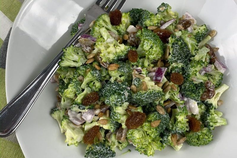 This is the Best Easy Broccoli Raisin Salad Recipe ever! It's so simple to make and you only need 8 ingredients. Perfect for get-togethers and parties. #broccoli #broccolisalad #salad #easy #best #simple #raisins #sunflowers #breagettingfit