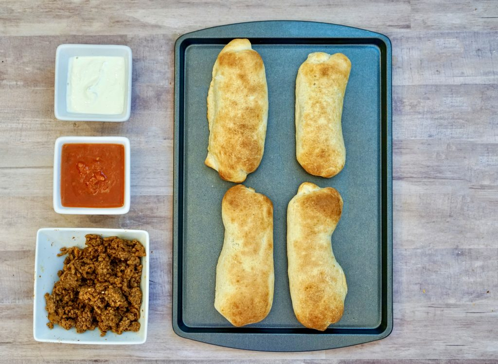 Taco Rollup Recipe - This incredible Taco Rollup Recipe will make you drool. It smells amazing as it bakes and it's easily customizable. Perfect for busy weeknights too! #taco #easy #dinner #rollups #breagettingfit