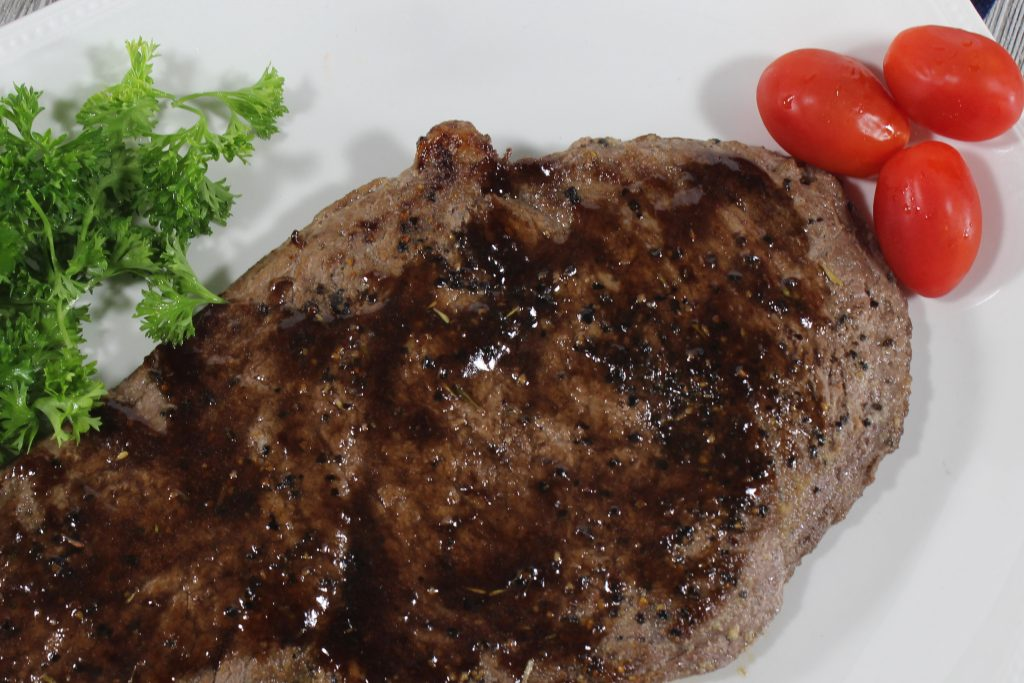 Delicious Sirloin Tip steak smothered in a wine sauce is out of this world. Every bite is juicy, full of flavor and leaves a lasting impression. #steak #dinner #easy #redwinesauce #sauce #delicious #breagettingfit