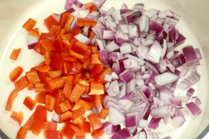 cut peppers and onions in pan