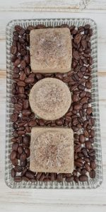 coffee soap with beans around it on plate
